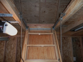 """Our roomy 30""""x60"""" Pull-down ladder"""